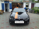 foliendesign vollverklebung design bmw schwarz orange